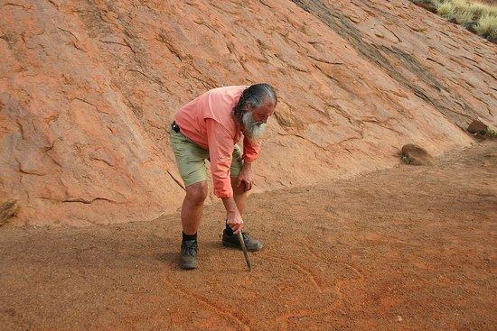 Desert Awakenings Tour: Ned Thompson illustrating the formation of Uluru