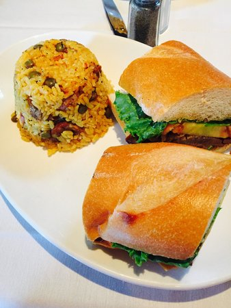 Coquito: Pernil sandwich with arroz con gandules
