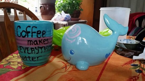 Clay Cafe Pottery Studio : My coffee cup and my sister's whale, not bad for a 1st time!