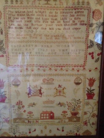 Rose Manor Bed and Breakfast : Beautiful antique needlework sampler in family room...from 1789, worked by a 9 year old!