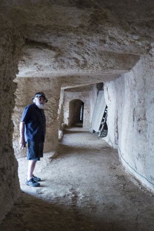 Eurialo Castle: A friend exploring the tunnels that allowed troops to pass quickly in safety