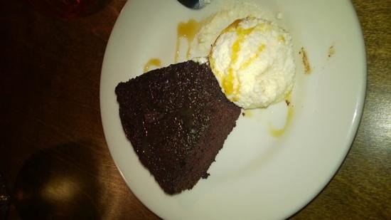 Twisted Cuban Cafe & Bar: dessert. please note the white ball is not icecream...this is some type of cream