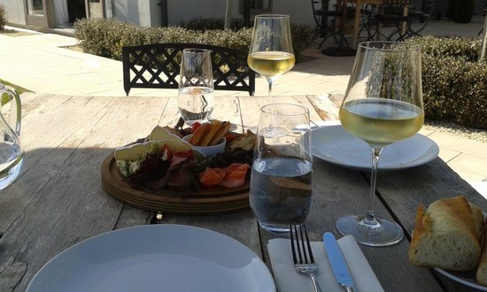 Poppies: Platter and wine in the sunshine