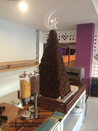 The Hills Batam: Tower of dried dates on display during breakfast