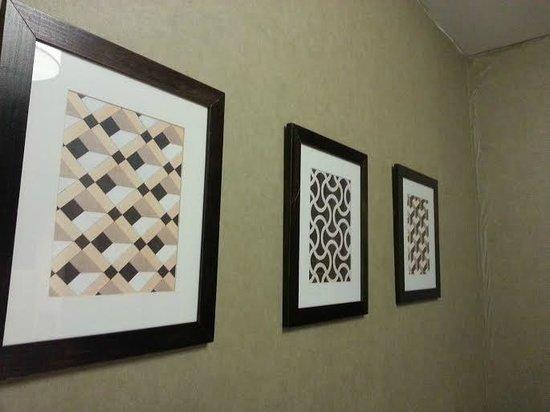 "on wall & ""melting"" wallpaper from leak in sleeping area"