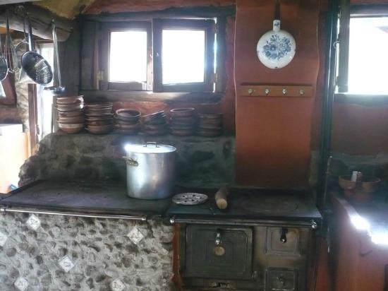 Un lugar c lido para la familia y rom ntico para las - Cocina a lena ...