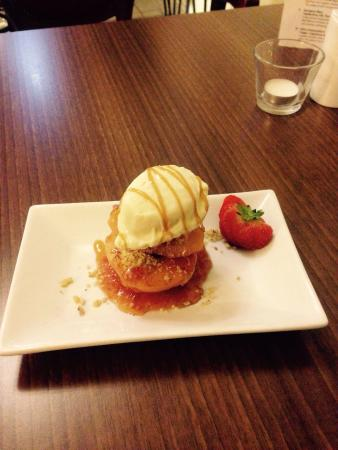 Konak Meze Turkish Restaurant : Roasted Quinces with almonds and ice cream & topped with chefs special sauce.