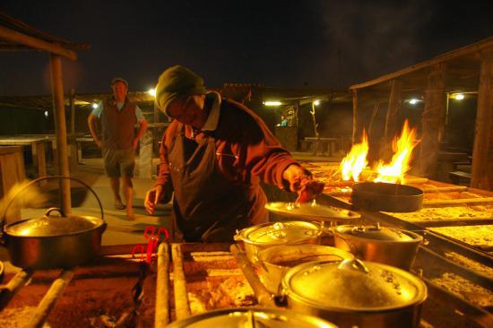 Muisbosskerm: cooking over open fire