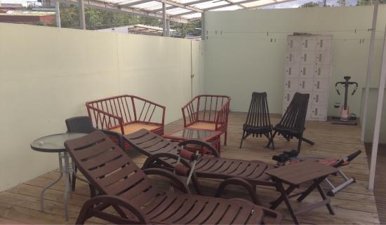 كلرز أواسيس ريزورت: Sundeck area with eclectic selection of furniture and gym equipment.