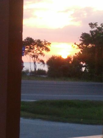 Sunset Grill Incorporated: Sunset view from indoors by the window