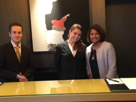 Grand Hotel du Palais Royal: Hotel front desk staff with manager, Nirusha on the right -
