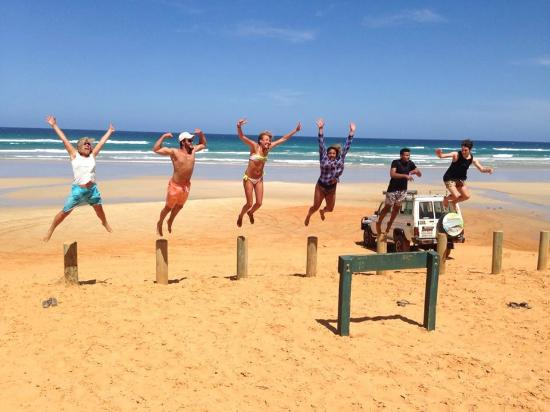 Jumping for joy at Red Canyon - Picture of Noosa 4WD Eco