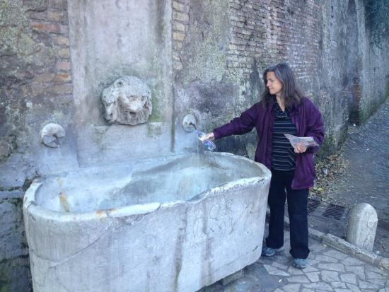 Roma Trasteverina B&B: filing our water bottle at a nearby fountain.
