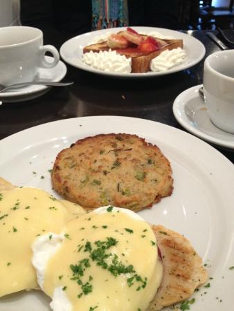 Douceur de France: Eggs Benedict and french toast in the background.