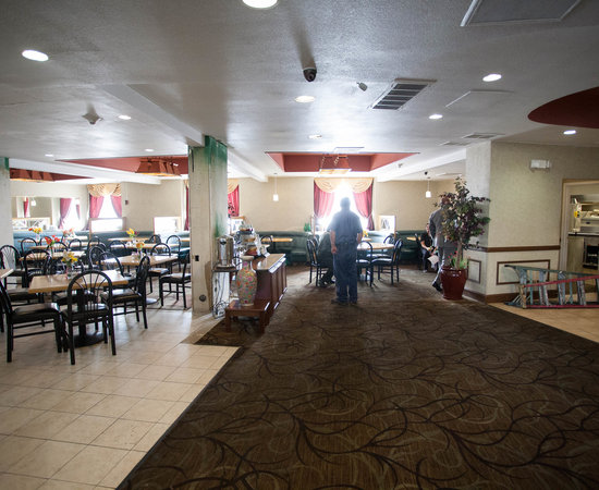 Palm Grill Restaurant & Bar at the Quality Inn Central Denver