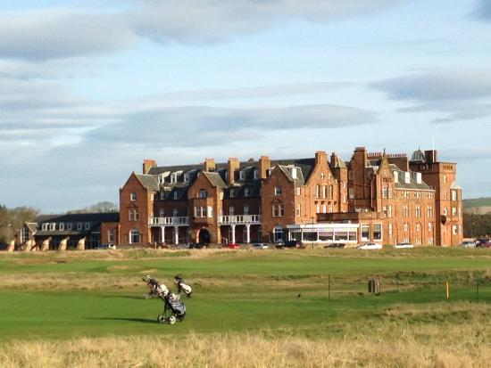 The Marine Hotel: View of the hotel from the beach across the golf course