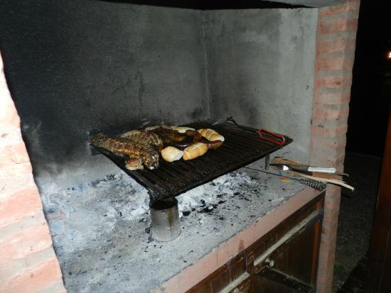 Altos de la Costanera - Aparts: Corderito Patagonico en la parrilla.