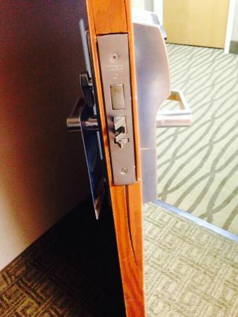 Comfort Suites: Was wondering why the door was tough to lock. Door was split, as if someone had kicked the door