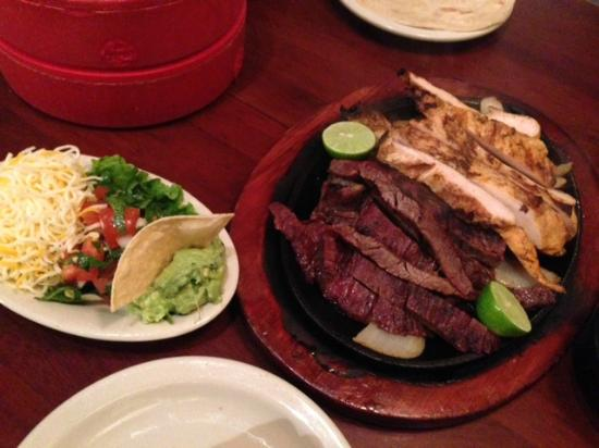 Gringo's Mexican Kitchen: Sizzling Mixed Fajitas, sides and Warm, Soft Flour Tortillas!