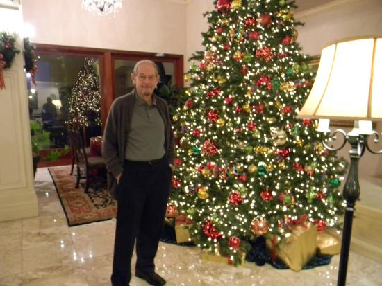 Ayres Hotel & Suites in Costa Mesa - Newport Beach: My husband in the newly decorated lobby near the welcoming fireplace.