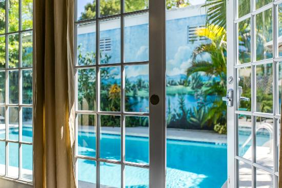 Rose Lane Villas French doors open to the swimming pool in the 2 bedroom Villa & French doors open to the swimming pool in the 2 bedroom Villa Aqua ...