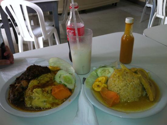 Mustor's Restaurant: Chicken and cou-cou (left) and fish with peas and rice (right)