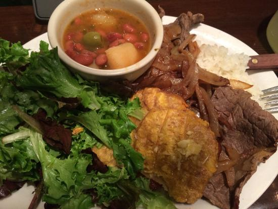 Sol Food Puerto Rican Cuisine : Bistec combo (small). Fresh greens, plantains, thinly sliced steak with grilled onions, pink bea