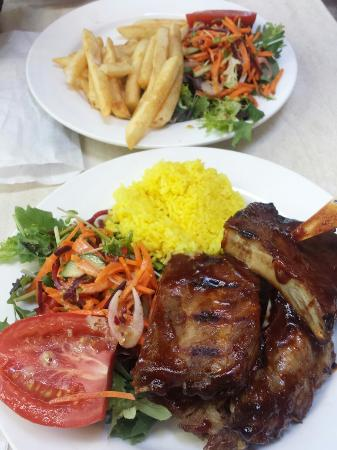 Breakfast Creek Hotel : Half-rack ribs with rice and salad $35 (the extra plate of chips and salad was $8 extra)