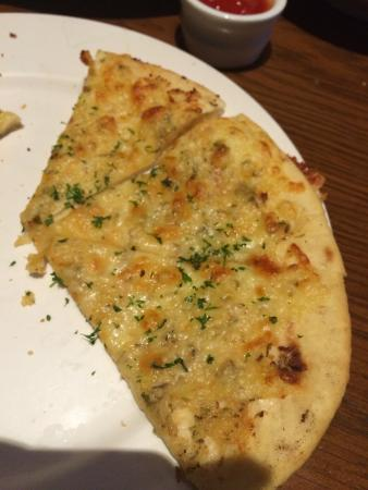 Pub On Wharf : Xperienced some very bad food at Pow. This garlic bread was made with sour jar garlic instead of