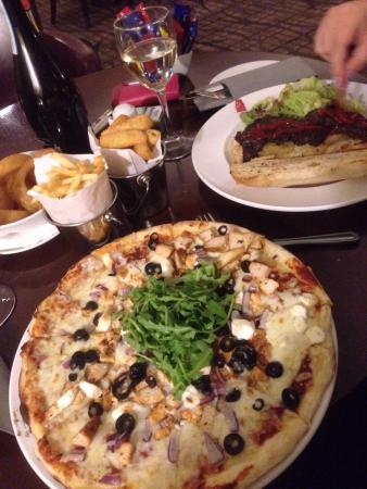 T3 Bar & Restaurant: Chicken, goat's cheese and rocket pizza with French fries.   Steak and cheese sandwich with ch