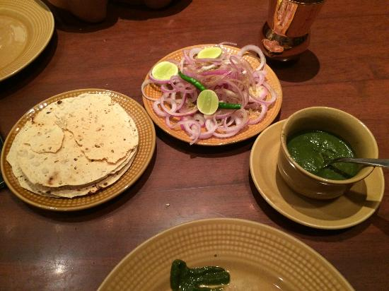 Peshawri: The munches before the food ... Indian papad, onions and the green chutney