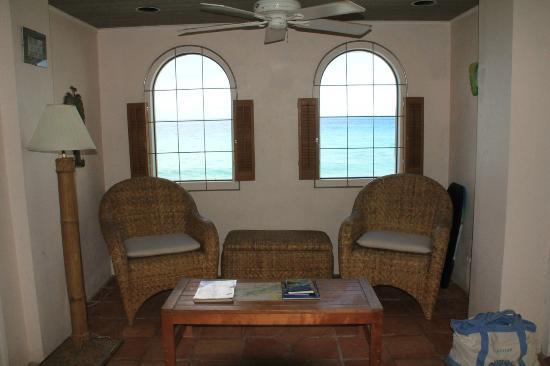 "AppleSurf Seaside Villas: living room with 52"" fan for cooling breezes"