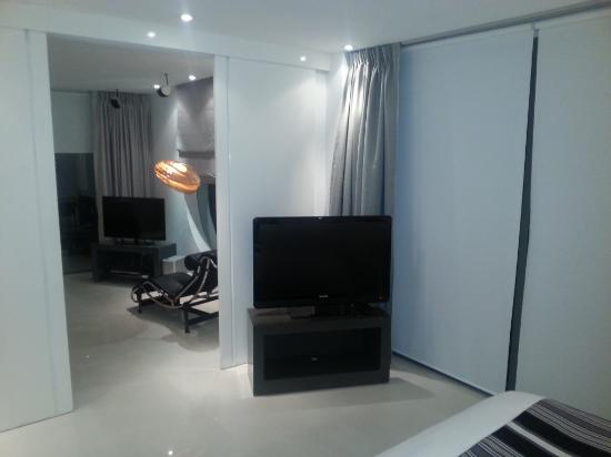 BYD Lofts Boutique Hotel & Serviced Apartments: Looking from the bedroom into the living room.