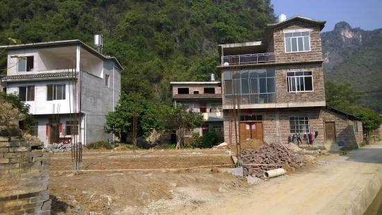Jiuxian Ancient Village: new bulding displace old styled houses