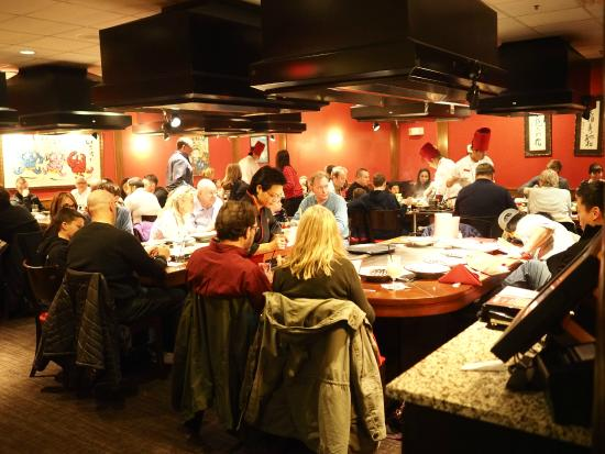 Benihana Busy Dining Room With Multiple Crowded Tables On A Weekend Dinner