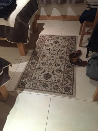 Eyre Square Townhouse: Poor floor covering, with tiles that failed to insulate room from either cold or noise