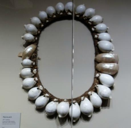 Bowers Museum of Cultural Art: Giant cowrie necklace compared to the small label