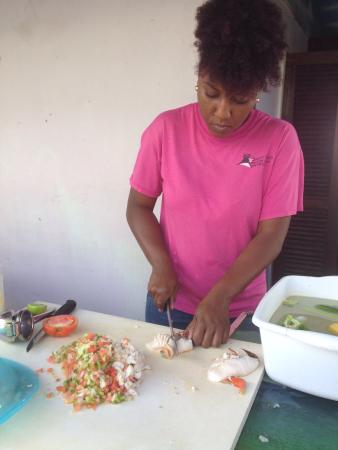 Queen Conch: Preparing the salad. She was SO kind! Very lovely conversion while I eagerly awaited my deliciou