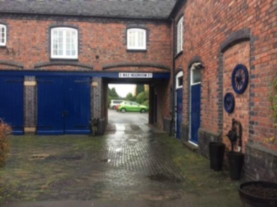 Drayton Court Hotel: entrance to onsite car park - old stables