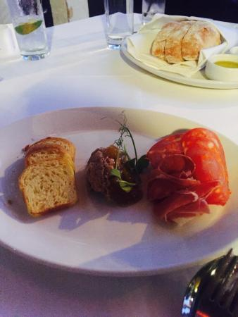 Jervois Steak House: Duck pate, prosciutto, and chorizo with a loaf of ciabatta.