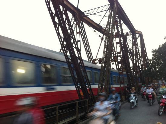 Long Bien Bridge: Train & scooters