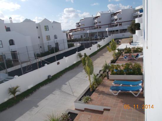 Siroco Serenity Solo Adultos: bedroom window view - Siroco apartments on left