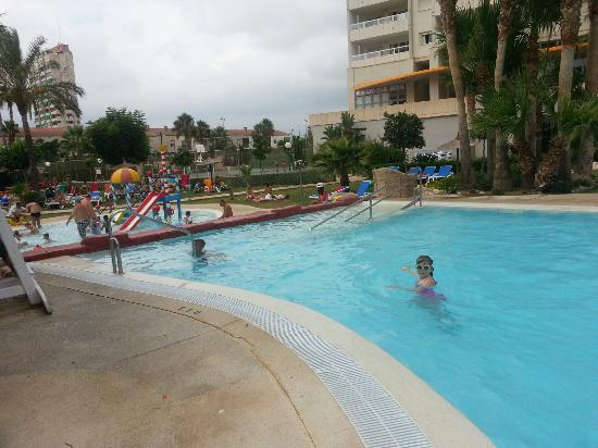 Gemelos XXII Apartments: my grandaughter in one of the pools