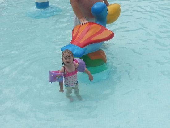 Gemelos XXII Apartments: one of my grandchildren having fun in the pool