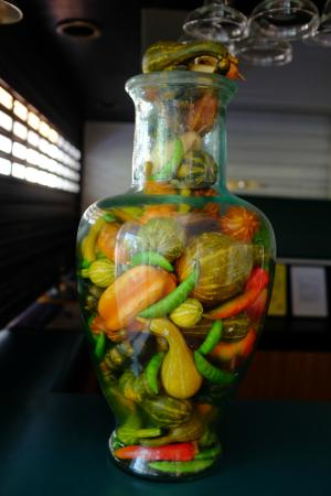 Ibis Styles Cairns: Vase of gourds