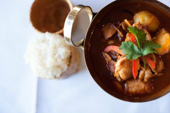 chiang mai chicken red curry intense with thai herbs, tamarind sauce ...
