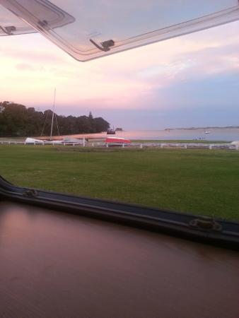 Mangawhai Heads Holiday Park: View from our caravan waiting for sunset