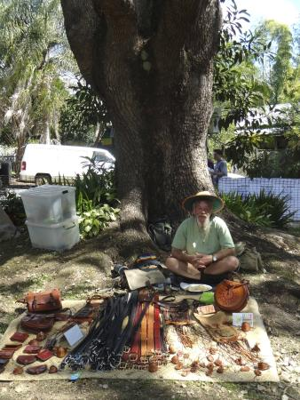 Nimbin Markets: The famous Les sitting at his iconic blanket stall selling his leather goods under the tree :)