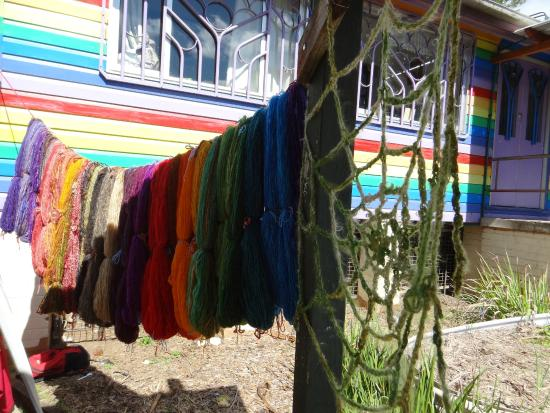 Nimbin Markets: Some colourful skeins and a spider web hung from the rainbow community centre.