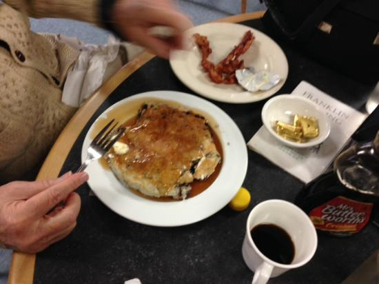 Franklin, ME : Blueberry pancake with rasher of bacon